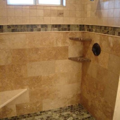 Travertine with mosaic shower