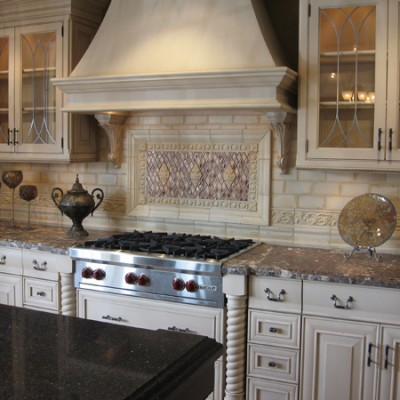 Subway tile with rhomboid insert backsplash
