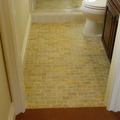 Yellow tumbled travertine floor