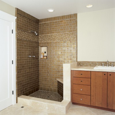 Travertine tile floor oceanside glass shower