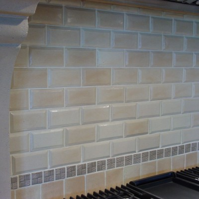 Beveled tile with mosaic backsplash