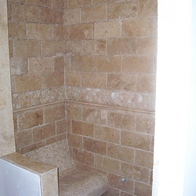 Chisled travertine with bench shower
