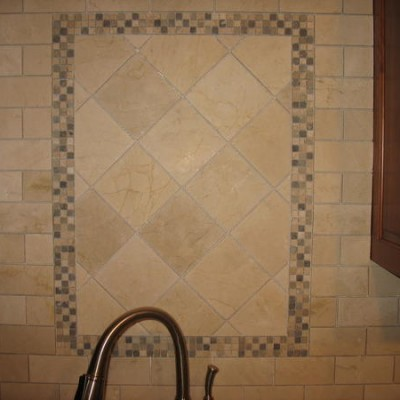 Crema marfil with mosaic backsplash