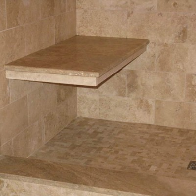 Custom travertine bench in shower