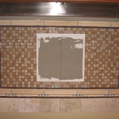 Glass mosaic with mural backsplash