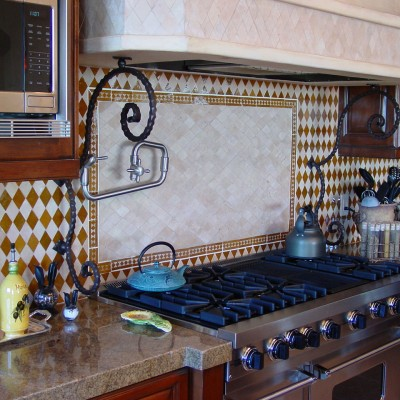 Handmade tile with travertine mosaic center backsplash