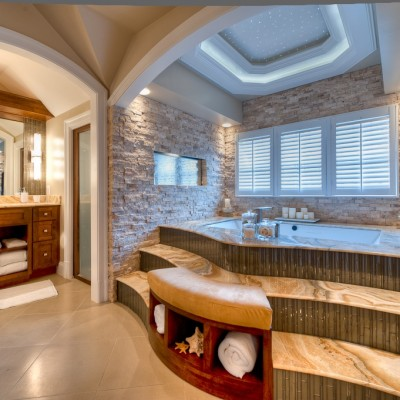 Ledger stone walls onyx tub