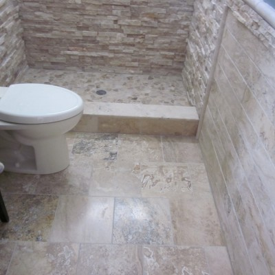 Ledgerstone bathroom with travertine floor