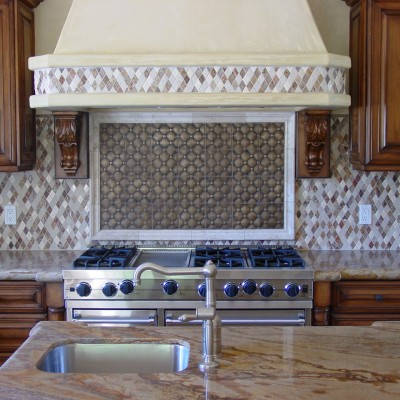 Mixed marble rhomboid mosaic with metal insert backsplash