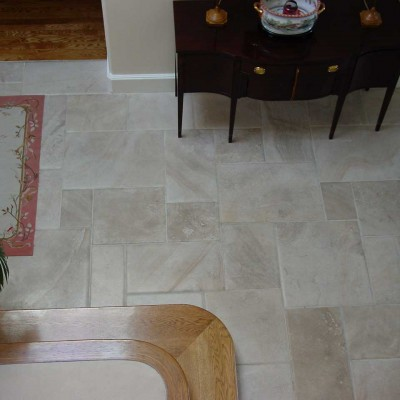 Pillowed edge versailles floor
