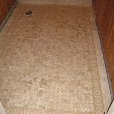 Travertine mosaic with liner design floor