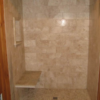 Travertine with bench in shower