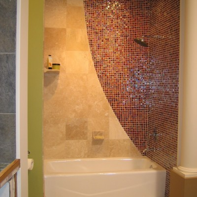 Travertine with glass mosaic wall