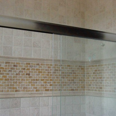 Tumbled travertine with yellow insert shower