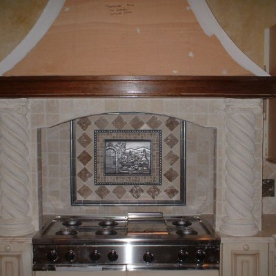 Tumbled travertine with metal backsplash