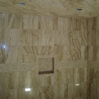 Vein cut travertine with mosaic border shower