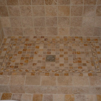 Yellow travertine mosaic shower floor