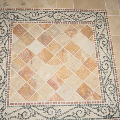 Yellow travertine with mosaic border floor