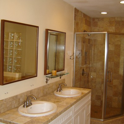 Yellow tumbled travertine bathroom