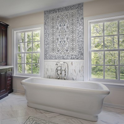 Master bath with large white tub